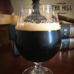 Oatmeal Stout Homebrew Recipe in snifter glass with The Mill logo
