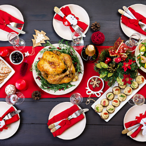 Traditional Christmas dinner with red place settings and snowflake decor